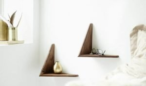 Cadovius butterfly shelves complementing a white wall, and acting as bedside tables.