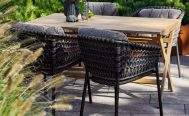 Ocean Outdoor Dining Chair in Dark Grey with the Natté Grey Optional Cushion Set at a table - Danish Design Co Singapore