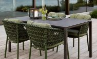 Ocean Outdoor Dining Chair in Dark Green at a table - Danish Design Co Singapore