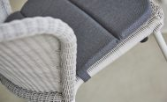 Close up of Lean Outdoor Dining Chair in White Grey Cane-Line Weave with a Dark Grey Cushion