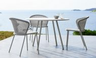 Lean Outdoor Dining Chair in White Grey Cane-Line Weave around a table