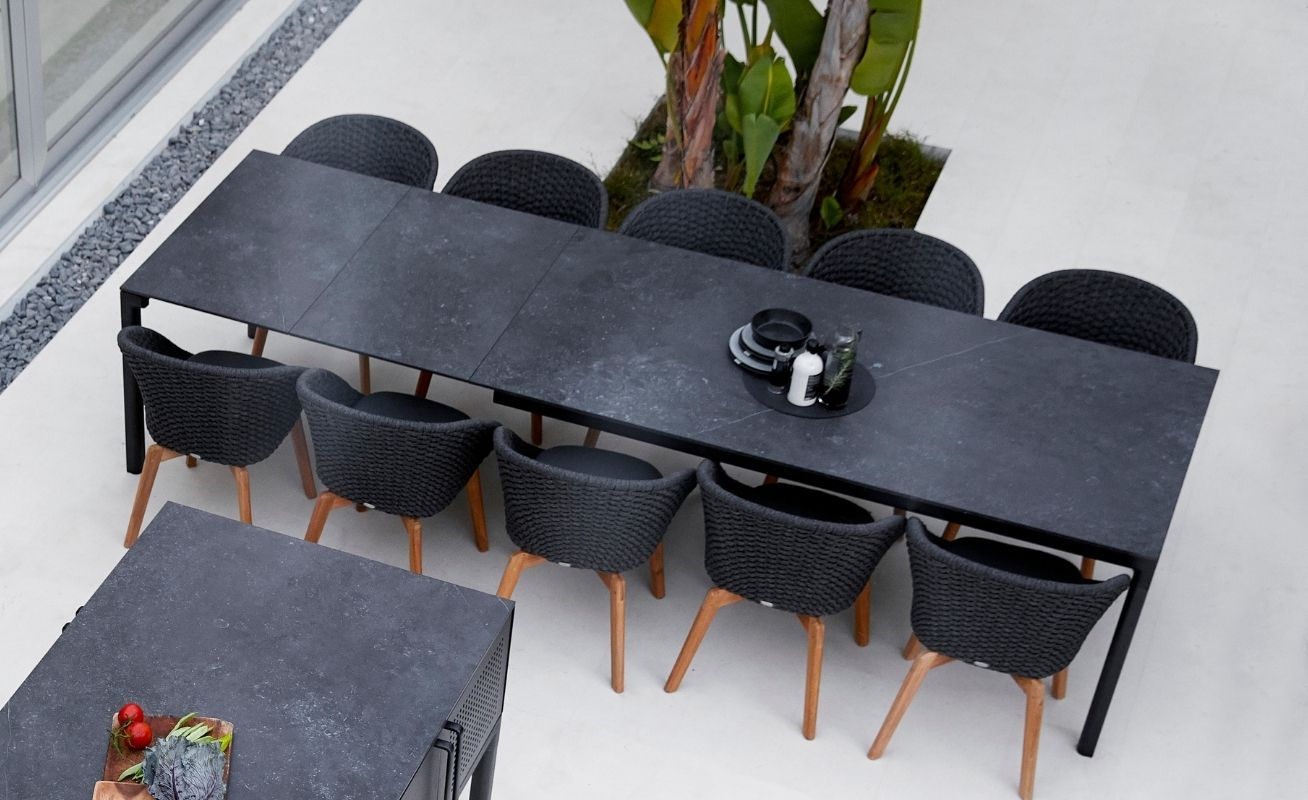 Drop Outdoor Dining Table with Lava Grey Aluminium frame with a Black Fossil Ceramic Table Top