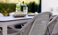 Drop Outdoor Dining Table with Light Grey Aluminium frame with a Black Fossil Ceramic Table Top