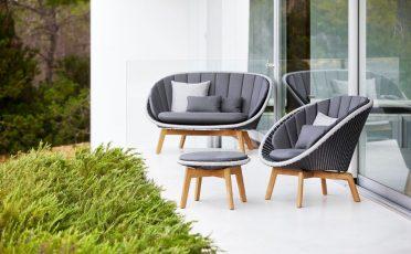Cane-line Peacock 2 Seater Outdoor Sofa dark grey frame with a light grey rim, with dark grey cushions