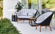 Cane-line Peacock 2 Seater Outdoor Sofa dark grey frame with light grey cushions