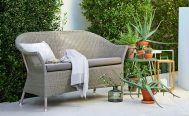 Lansing 3 seater outdoor sofa in taupe cane and taupe cushions in an outdoor setting - Danish Design Co Singapore